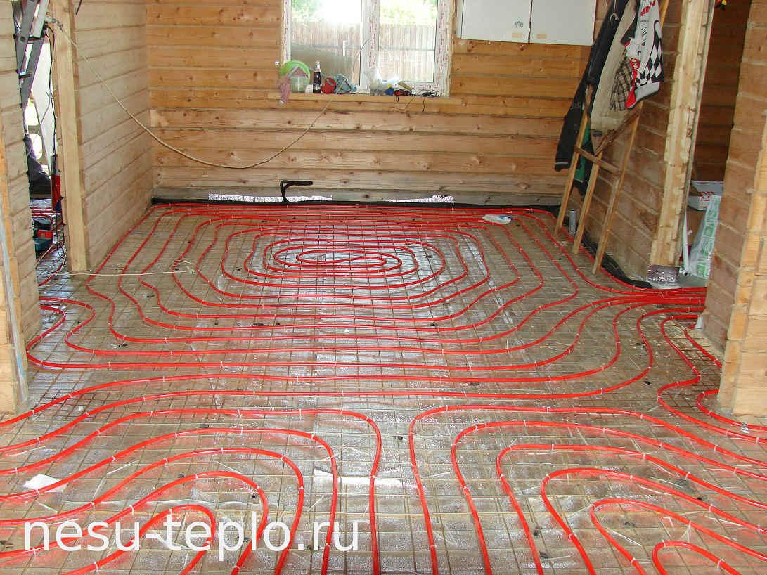 Водяной теплый пол в доме из бруса на сайте nesu-teplo.ru